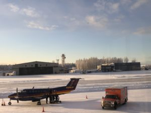 Gravel runways can be maintained during winter by allowing a thin layer of snow to freeze permanently on the surface