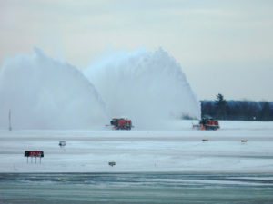 Cleaning the runway of snow using ploughs and blowers