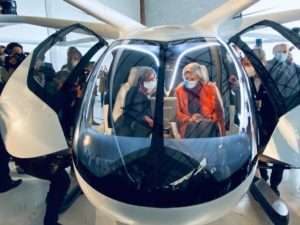 Visitors sit in the VoloCity eVTOL at a recent Groupe ADP event in Paris